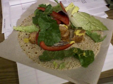 Sausage, lettuce, red pepper wrap with mustard